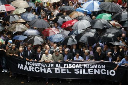 Protesters hold a banner during a silent march to honor late state investigator Alberto Nisman in Buenos Aires