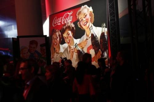 The Coca-Cola Company logo is pictured during a presentation in Paris