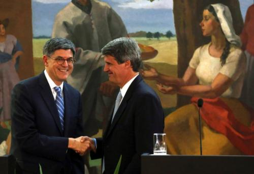 Argentine Finance Minister Alfonso Prat-Gay and U.S. Treasury Secretary Lew shake hands after giving a joint statement in Buenos Aires